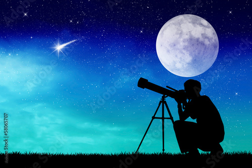 Man looks into the telescope