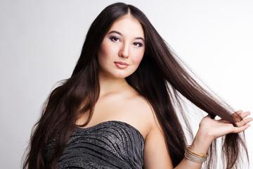 Hair. Beautiful Brunette Girl. Healthy Long Hair