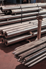 steel fabrication, metal bars stored in warehouse