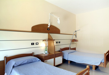 hospice room, with two beds and furniture