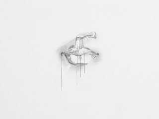 Detail of lips pencil drawing on white paper