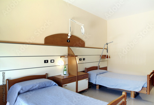 hospice room, with two beds and furniture - 58066512