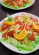 salad with chicken, tomato, orange and parmesan