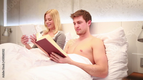 Concept shot of couple with book and digital tablet