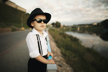 little gentleman with sunglasses outdoors