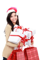 Young woman in christmas hat / santa with shopping bags and gift