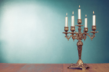 Vintage bronze candlestick with five burning candles