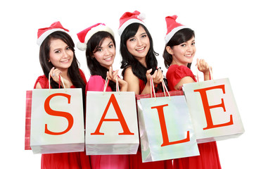 Picture of beautiful four asian women in red dress with shopping