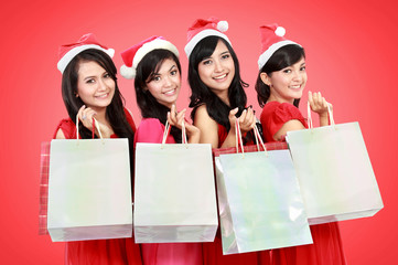 Happy funny people with christmas santa hat holding gift boxes a