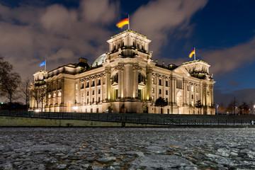 Reichtstag by night with frozen river Spree