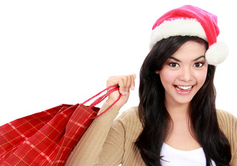 Young woman in santa hat with shopping bag