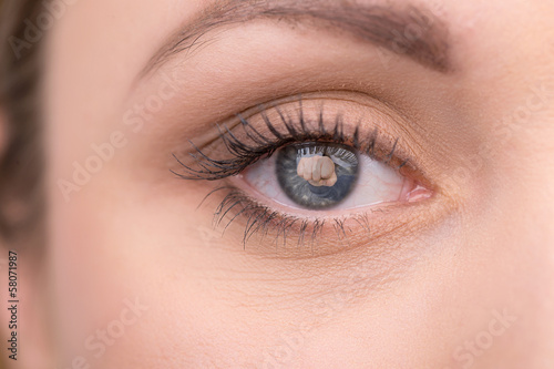 Creative shoot of woman eye with knock reflection.