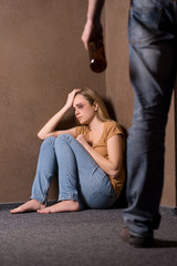 Despaired woman beaten by drunk man.