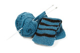 striped scarf on knitting needles