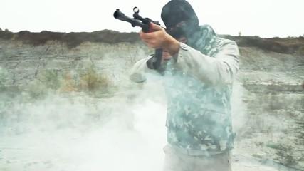 Gunman Terrorist Assassin Walking Through Smoke Desolation