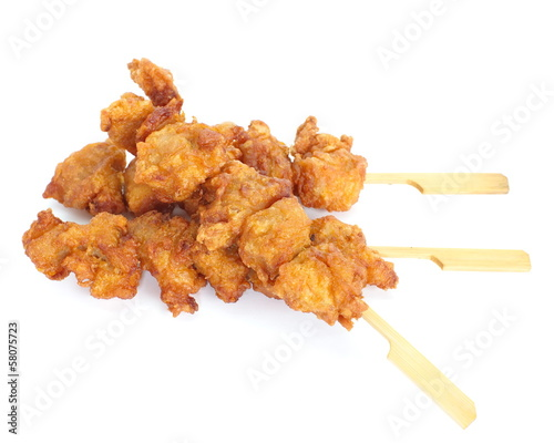 Fried chicken with skewer on white background