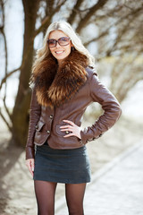 Fashion portrait of a beautiful woman in sunglasses outdoor