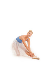 Graceful supple ballerina stretching to her toes