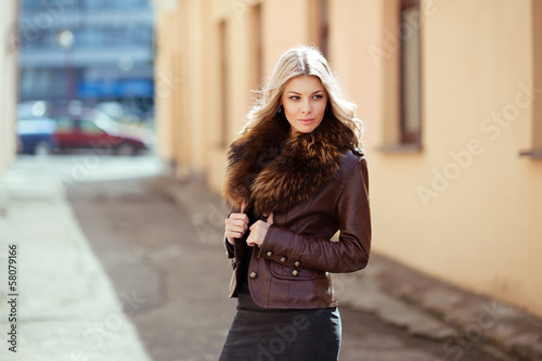Portrait of a young woman. Outdoors