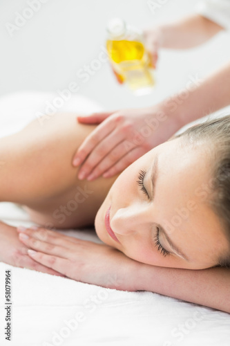 Beautiful woman enjoying oil massage