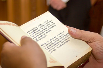 closeup of hands holding a gospel