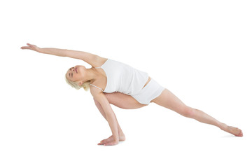 Full length of a sporty young woman practicing yoga