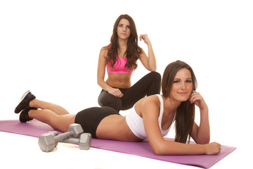 Two women fitness one lay on floor