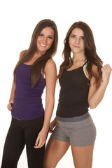 Two women fitness stand smile hand hair