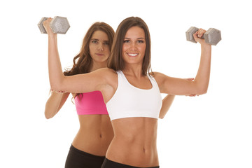 Two women fitness train behind