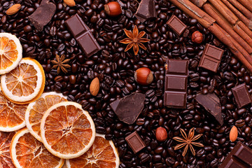 Background of coffee beans, chocolate chips, spices, nuts and ca
