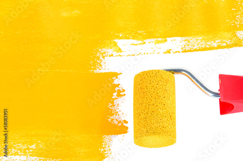 Roller brush with yellow paint
