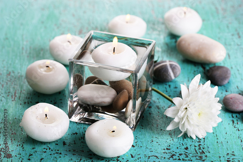 Decorative vase with candles, water and stones