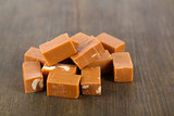 Many toffee on wooden table