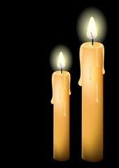 Two Lit Candles isolated on black.