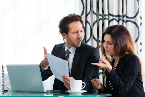 Boss and assistant or in hotel working together