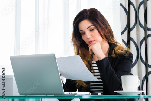 businesswoman in hotel working with agreement
