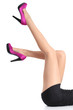 Beautiful woman legs with fuchsia high heels