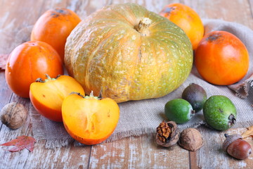 Pumpkin, persimmons and other fruits on the table