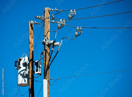Detailed image of power lines and connections on a wooden post