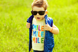 Stylish baby boy with ginger (red) hair in trendy sunglasses