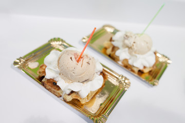 Two desserts on metallic trays