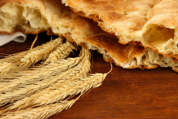 Pita breads with spikes on table close up