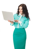 smiling brunette girl in green skirt and blouse holding laptop