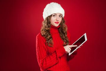 brunette girl  holding ipad touchs screen