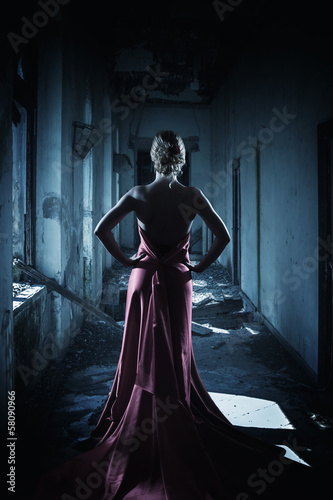 The elegant thin woman in a long dress