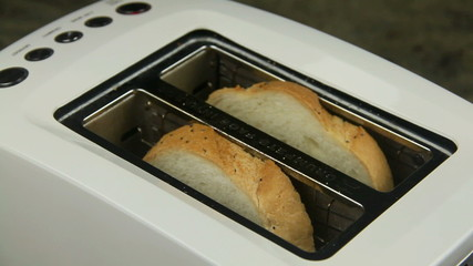 Two slices of bread put in a toaster