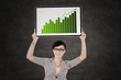 Business woman showing growth graph