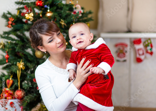 mother and baby at Christmas tree