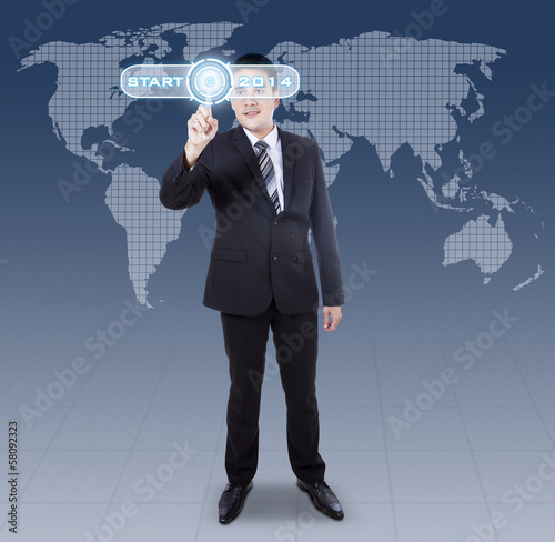 Businessman pressing digital button