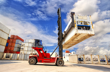 forklift handling the reefer container box at dockyard